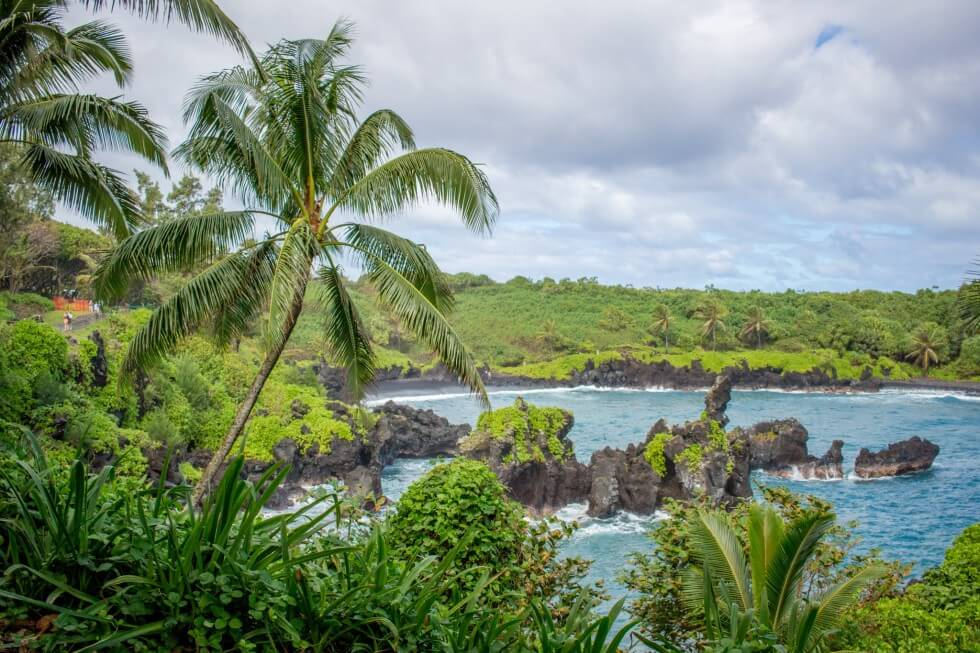 Looking at Mauis black sand beach