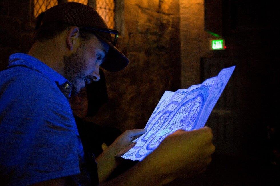 Blacklit Spell Map in Knockturn Alley Visiting Harry Potter World Orlando